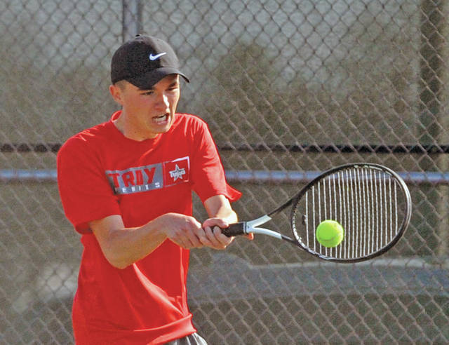 Josh Brown|Miami Valley Today Troy's Nathan Kleptz hits a backhand during a match at first singles Wednesday against Lehman.