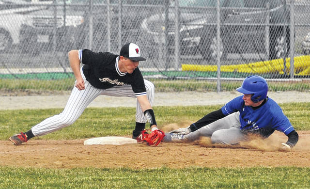 Josh Brown|Miami Valley Today Newton third baseman Mitchell Montgomery tags out Miami East's Dave Osting at third base Thursday at Newton High School.