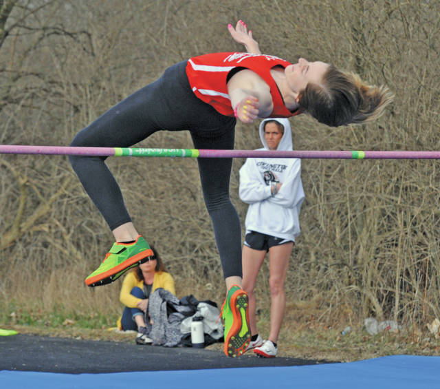 Josh Brown|Miami Valley Sunday News Milton-Union's Ally Lyons clears the bar in the high jump at the Miami East Invitational Friday.