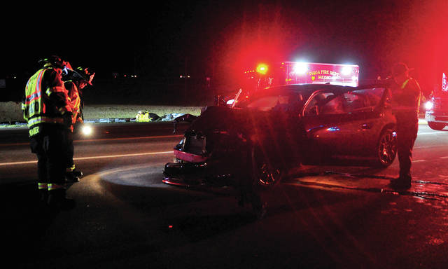 Firefighters from Covington and Piqua check for safety hazards following a two-car crash on Co. Rd. 25-A at the Farrington interchange on Saturday evening. Both drivers and a reportedly unrestrained toddler were transported to Upper Valley Medical Center with non-life-threatening injuries. The crash is being investigated by the Ohio State Highway Patrol.