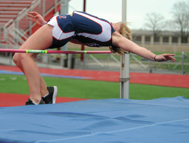 Piqua's Aubree Schrubb clears the bar in the high jump Wednesday at Alexander Stadium/Purk Field.