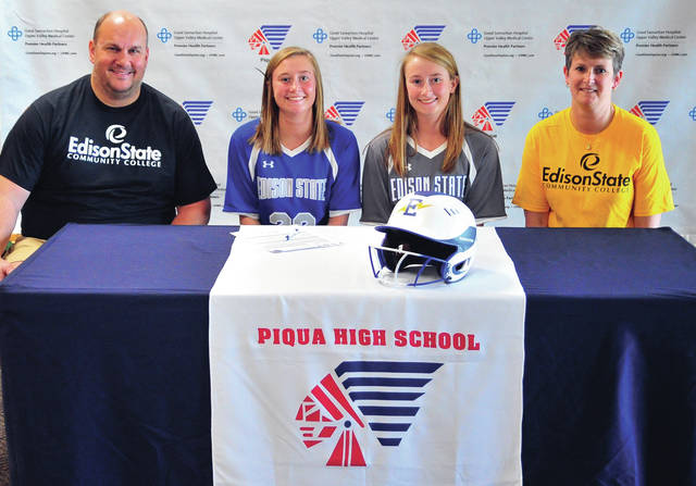 Mike Ullery | Miami Valley Today Piqua High School seniors Kamy and Kylie Trissell signed their letters of intent to play softball for Edison State Wednesday. From the left are father Dave Trissell, Kylie Trissell, Kam Trissell and mother Jenny Trissell.