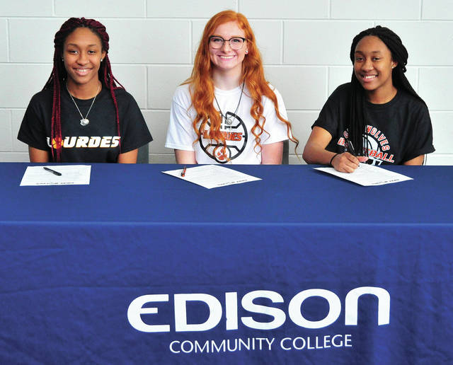 Mike Ullery | Miami Valley Today From the left, Edison State Community College sophomores Kailani Broyles, Lauryn Gray and Kaylesha Broyles signed their letters of intent to play basketball for Lourdes University next season.