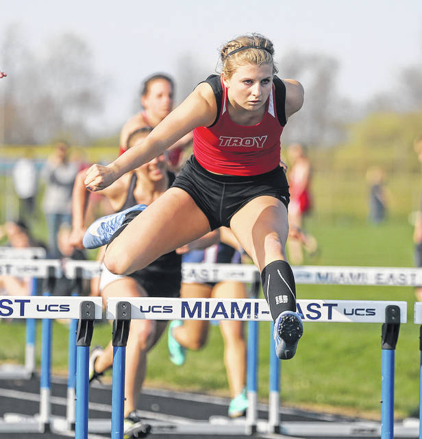 Lee Woolery|Miami Valley Today Troy's Jessica Goodwin won the 100 hurdles at the Miami County Championships Tuesday at Miami East High School.
