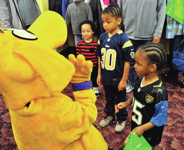 Sebastian Shaw, 2, Nauyn Williams, 5, and Kingston Williams,3, all from Piqua, visit with one of the cartoon characters at The Valley Church in Piqua on Saturday. The church hosted a number of children's Easter-related events for kids from around the area.