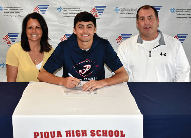 Mike Ullery Miami Valley Today Piqua High School senior Owen Toopes signed his letter of intent to play baseball for Edison State Community College. Shown with Toopes are his parents Jody (left) and Mike (right) Toopes.