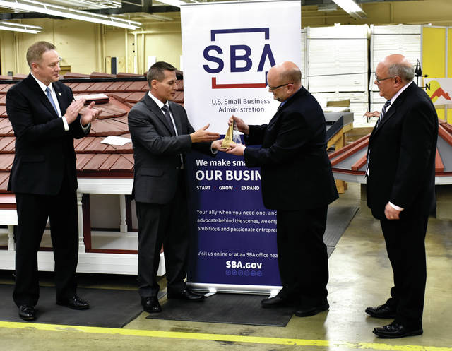 Everett Woodel, SBA District Director for South Central Ohio, second from left, presents the U.S. Small Business Administration Spark Award to Isaiah Industries CEO Todd Miller during a ceremony at the Piqua business on Friday. Pictured with Woodel and Miller are, far left, Congressman Warren Davidson, (OH 8th Dist) and far right Kelly Joseph CFO for Isaiah Industries.