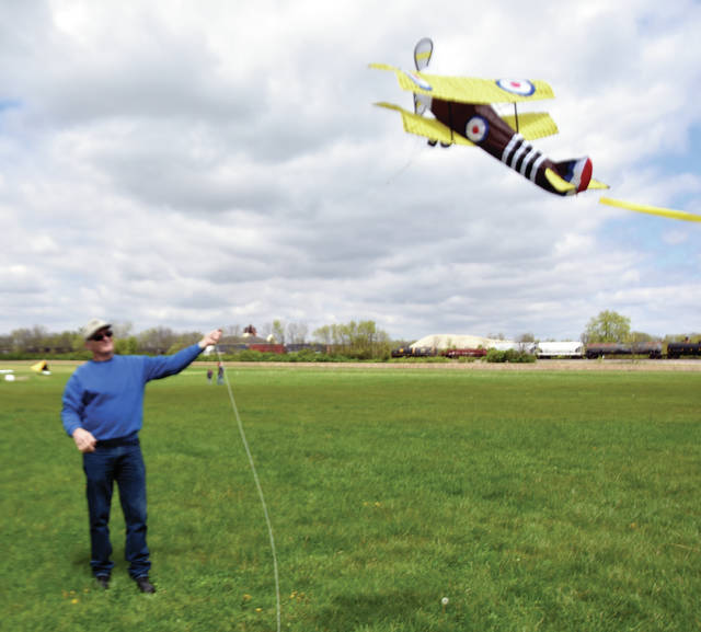 Kevin Adkins of Troy launches his Sopwith Camel kite during Sunday's Troy Noon Optimist Club and WACO Air Museum and Aviation Learning Center's annual Wings on Strings Kite Fly at WACO Field in Troy. ©2019 Miami Valley Today