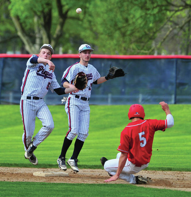 Piqua's Zack Lavey throws to force after getting a force of Troy's Jacob Adams at second base Monday at Hardman Field.