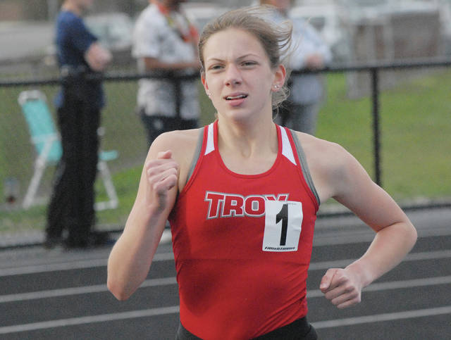 David Fong | Miami Valley Sunday News Troy's Dinah Gigandet won both the 800 and 1,600 Friday at the Xenia Doug Adams Invitational.
