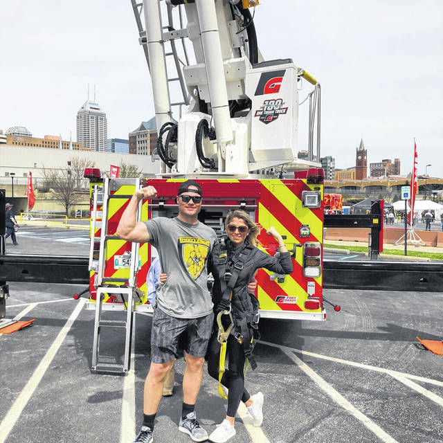 Courtesy photo Piqua firefighter Corbin Peltier at the Firefighter Combat Challenge at FDIC in Indianapolis earlier this month.