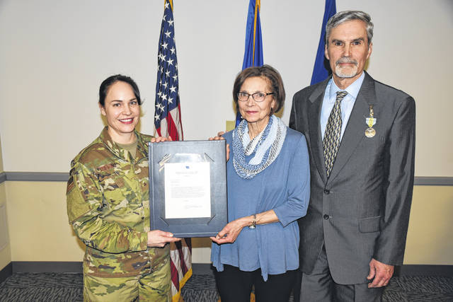 Courtesy photo Brigadier General Alice W. Trevino, Commander of the Air Force Installation Contracting Agency (left) with Mary Jo Koenig and Gary Koenig, who recently retired after over 40 years of federal service.