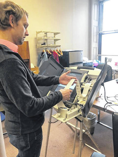 Miami County Board of Elections Deputy Director Ian Ridgeway conducts a ballot test on one its voting machines at the office on Tuesday. The board conducted a public test to prepare for the May 7 Primary.