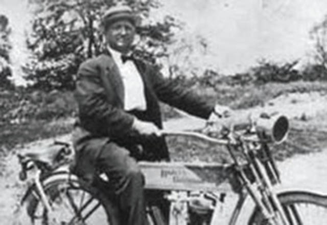 Contributed photo Chief Frank Gehle, Piqua's first Chief of Police, astride the department's motorcycle sometime around 1910.