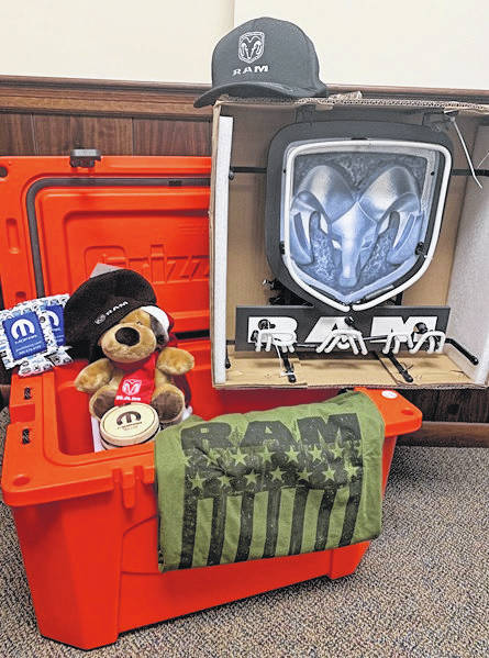 Provided photo An extensive package of Ram items will be auctioned with the cake donated by Sherry Chrysler Dodge Jeep at this year's Cakes for a Cause event. The cake will be on the auction block at 3 p.m. on Friday, April 26, at the Miami Valley Centre Mall.