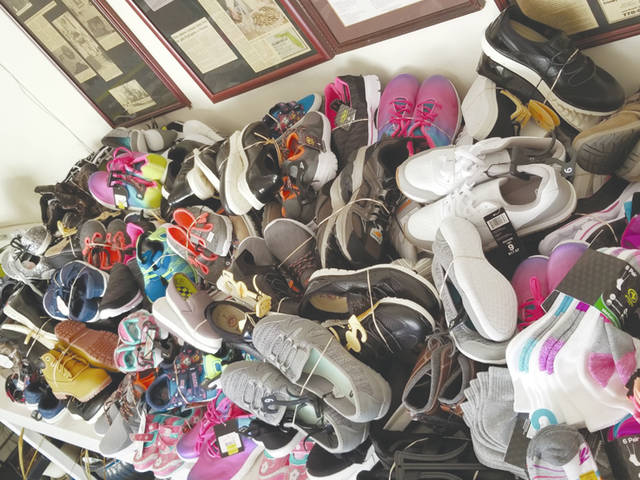 aec63f32ca Rotary donates to Shoes for Orphan Souls - Piqua Daily Call