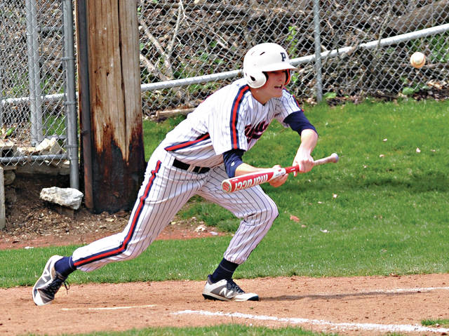 Rob Kiser|Miami Valley Sunday News Piqua's Blane Ouhl puts down a bunt against Urbana Saturday at Hardman Field.