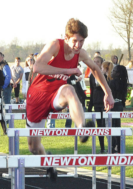 Miami Valley Today Photo Newton's Cameron Stine goes over a hurdle in the 110 high hurdles Friday at the Newton Twilight Invitational.