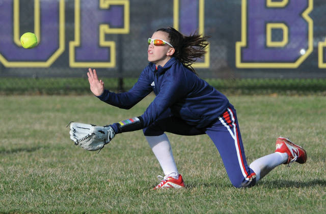 Piqua rightfielder Chaia Sowers makes a diving attempt at a fly ball Monday against Vandalia-Butler.