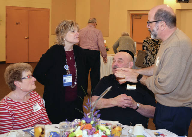 Provided photo Duanna Osting, UVMC Foundation president, talks with volunteers during annual volunteer recognition event.