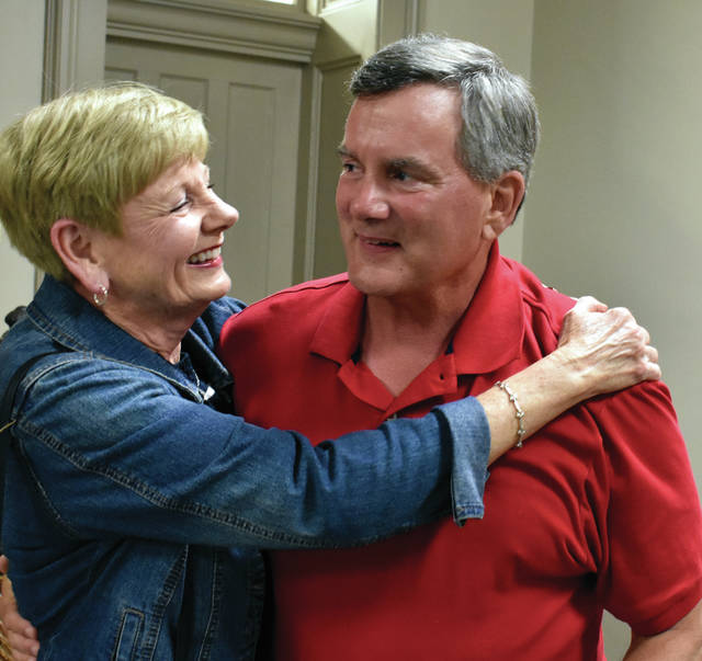 Troy resident Jeff Schilling is congratulated by his wife upon winning the 6th Ward Troy City Council race on Tuesday. His term will begin in 2020.