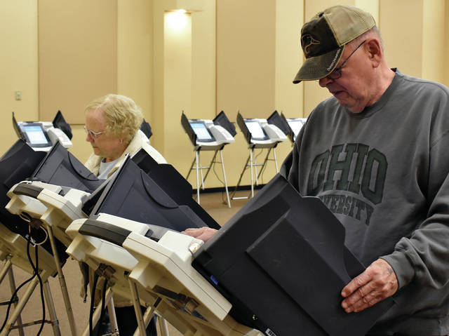 Jim and Phylis Otey of Piqua cast their ballots at the polls in Piqua on Tuesday ©2019 Miami Valley Today, All rights reserved