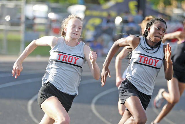 Lee Woolery Miami Valley Today Troy's Hannah Falknor (left) and Kiersten Franklin run the 200 at the GWOC meet Wednesday at Troy Memorial Stadium.