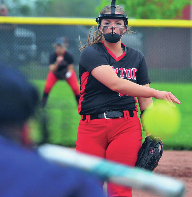 Newton's pitcher Erin Norman fires a strike against Covington Thursday in D-IV sectional action at Newton High School.