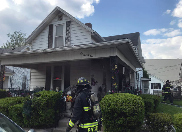 Firefighters from Piqua and Covington battle a kitchen fire at 622 Wood St. in Piqua on Wednesday afternoon.