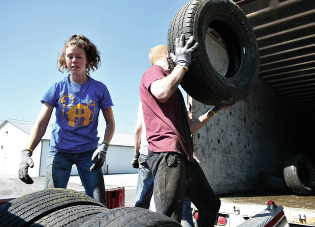 Miami East FFA students, including Paige Pence, Colt Merger, Seth Wills, Natalie Bair, and CJ Van Pelt, unload used tires during the annual Miami Soil and WAter Conservation District Tire Recycling day at the Miami County Fairgrounds. Linda Raterman of the MSWCD said that 1374 tires were collected. Another pickup is scheduled for September. Watch the Miami Valley Today for more information. ©2019 Miami Valley Today. All rights reserved