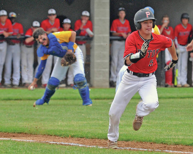 Josh Brown|Miami Valley Today Newton's Ryan Mollette races to first base as Russia catcher Will Sherman fields his bunt in the top of the first inning of Wednesday's Division IV district final in Versailles.