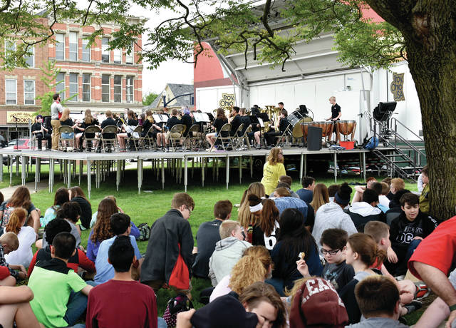 The Troy Junior High School 7th grade band performs a lunch concert on Prouty Plaza on Wednesday. A couple hundred students and adults enjoyed their lunch in the grass as they were entertained by the band. ©2019 Miami Valley Today, All rights reserved