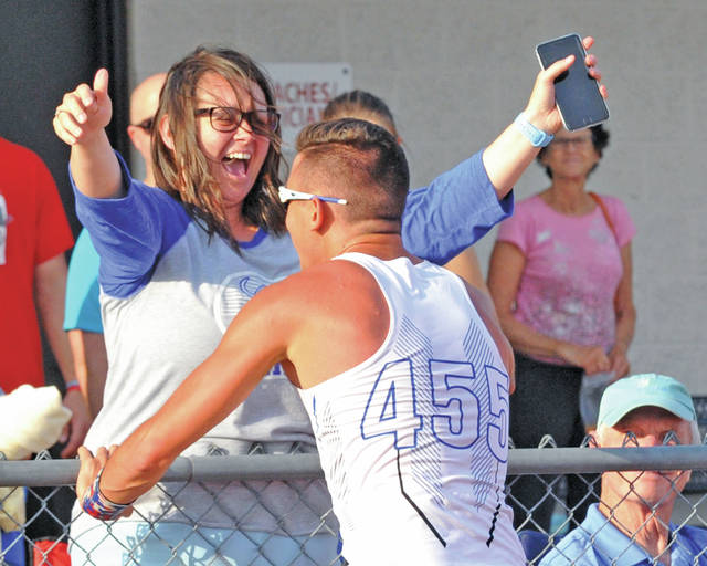 Josh Brown Miami Valley Today Miami East's Blaine Brokschmidt rushes to hug his mother Danelle after winning a regional title and clearing 15-9 in the pole vault at the Division II regional meet Thursday at Piqua High School.