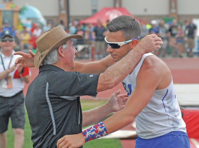 David Fong | Miami Valley Sunday News Miami East's Blaine Brokschmidt hugs pole vaulting coach Roger Bowen after winning a state championship Friday at Jesse Owens Memorial Stadium.