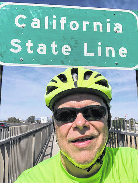 Provided photo Barry Minster of Troy in Oceanside, Cali., in March about to begin his cross-country cycling trip with his wife Barbara traveling along with him in a support vehicle.