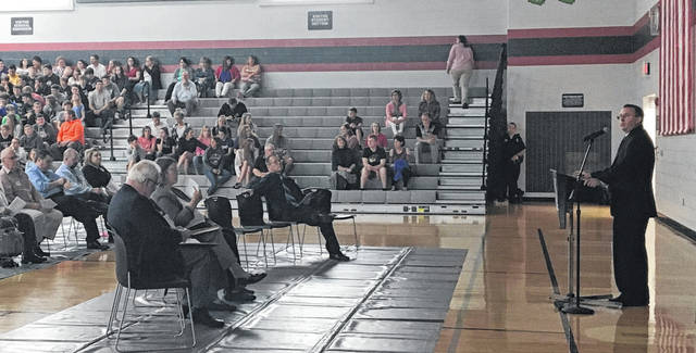Sam Wildow | Miami Valley Today Covington Superintendent Gene Gooding welcomes the community and students to their World War I commemoration and remembrance program on Thursday.