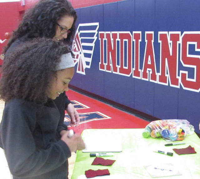 Sam Wildow | Miami Valley Today Mary Willis (back) with her daughter Nyla Willis (front) practicing place value games during Piqua Central Intermediate's annual Math Night on Tuesday evening.