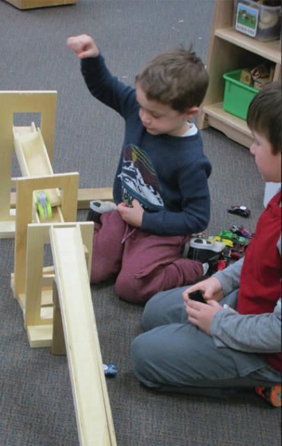Provided photo Children experiment with ramps and gravity in the block center of the Edison State Community College Child Development Center.