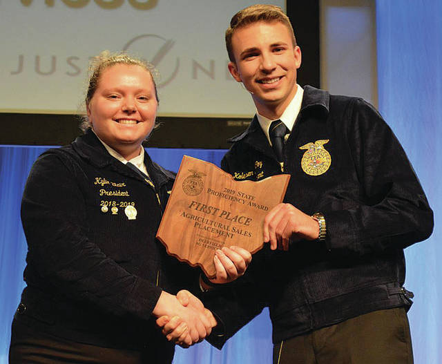 Provided photo Kylie Blair (left) was recognized as being the State Winner in the Ohio FFA Proficiency Award of Agricultural Sales-Placement. She received her award from State FFA President Koleson McCoy.