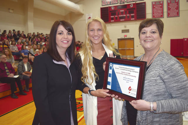 Provided photo Newton High School CBC/Vectren Lead The Way Scholarship winner Madison Hildebrand with Newton High Principal Danielle Davis and CBC's Dana Puterbaugh.
