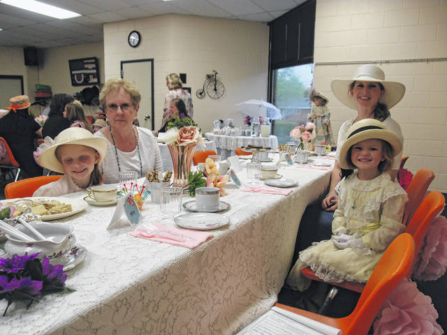 Provided photo On Thursday, May 16, Elizabeth Kolb brought her two daughters, Jacinta and Magdalen, along with their grandmother, to enjoy an old-fashioned tea party at the Milton-Union Public Library. They enjoyed tea and desserts with a lesson on etiquette.