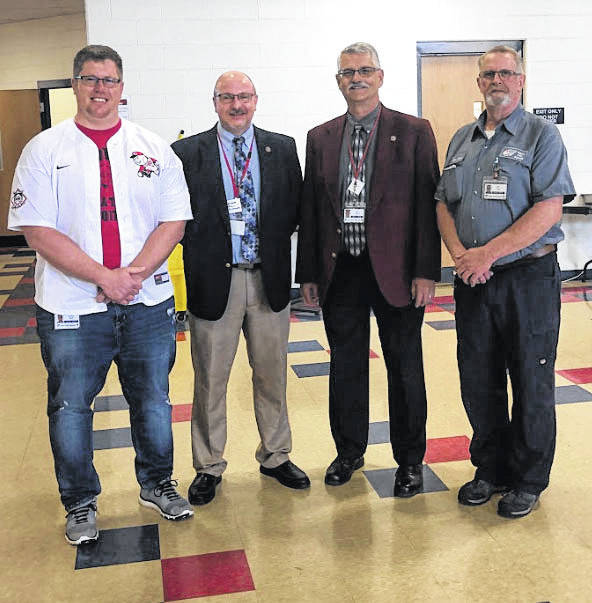 Provided photo From left to right, Piqua Junior High School teacher Josh Smith, Piqua City Schools Superintendent Dwayne Thompson, Piqua Board of Education President Andy Hite, and PJHS custodian Paul Doak. Smith was recently recognized as the District Teacher of the Year, and Doak was recognized as the Support Staff Member of the Year.