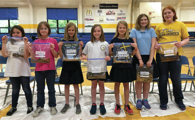 Provided photo Piqua Catholic School Students Evelynn Johnson, Anna Ray Scherer, Madison Rank, Olivia Sherry, Brooke Buecker, Kaydance Cameron, and Kennedy Stephenson donated hair as part of Piqua Catholic's 10th annual Hair-Cutathon.