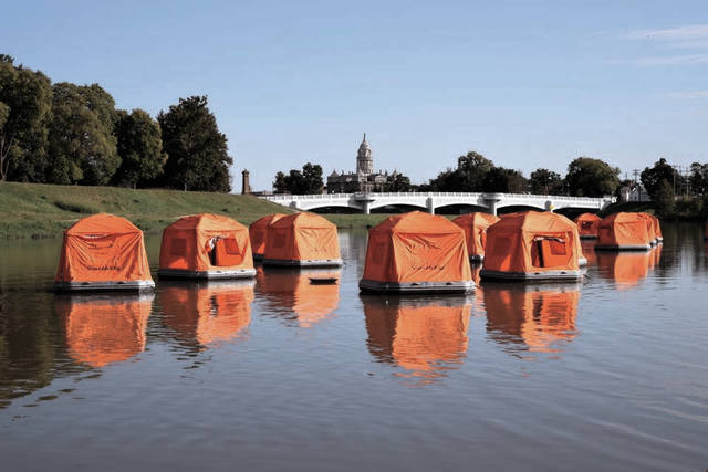 """Last fall, University of Dayton """"River Stewards"""" camped out on the Great Miami River in SmithFly Shoal Tents by Treasure Island Park. The city of Troy recently purchased 10 tents as part of its Great Miami River campground project. The rental of the floating tents will go public this summer through Adventures on the Great Miami on certain dates."""