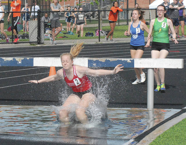David Fong | Miami Valley Sunday News Troy's Adrianna Burghardt placed third in the steeplechase at the Firebird Invitational.