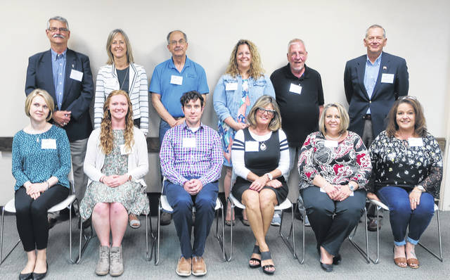 Provided photo Community Grant recipients seated from left to right: Ashley Schroeder of Elizabeth New Life Center, Shelby Hocter of Young Life, Sky Schelle of the City of Piqua, Kathy Sherman of Piqua Chamber Foundation, Carla Bertke of the Rehabilitation Center, and Tricia Stemen of SafeHaven, Inc. Standing from left to right: Andy Hite of Johnston Farm Friends Council, Laurie Reiser of C.I.S.V., Tom Downs of GIVE Medical Ministry, Stephanie Silk of Miami County Dental Clinic, Gary Kuziensky of Eagles' Wings Stable, Inc., and Randi Pearson, Piqua Community Foundation distribution co-chairman.