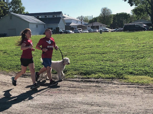 Tipp City residents Megan Shaffer and father Randall, along with their dog Killian, participated in the annual Miami East FFA 5K for K9s race at the Miami County fairgrounds. Approximately 80 people and their four-legged friends participated in the event. All proceeds benefit the Miami County Animal Shelter. The event was sponsored by the Miami Valley Today, Miami Valley Career Technology Center, Nationwide Insurance — Graves-Fearon Agency, Data Roofing, Coldwater Cafe, Miami East FFA Alumni, Trotwood's New York Pizzeria, Schirbyz Party Rental, Miami County Fair, Holly's Cafe and Carryout and Troy Sports Center.