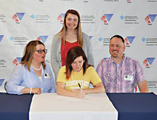 Piqua High School senior Izzy Kidwell signed her letter of intent to play basketball for Edison State Community College. In front with Kidwell are her aunt and uncle Brandy and Joshua Pierce. In back is her cousin Aubrey Pierce.