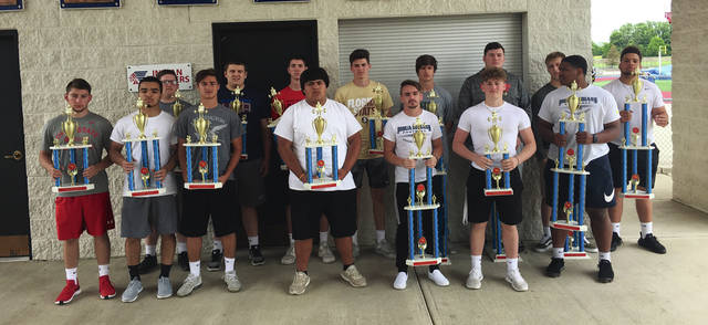 Piqua Football Lift-A-Thon winners included front row (left to right) Silas Bragg, Ca'ron Coleman, Jasiah Medley, Jon Delasancha, Colin Roe, Dylon Sever and Lance Reaves-Hicks. Back row (left to right) Bill Dobbins, Caleb Lyons, Garrett Schrubb, Blane Ouhl, Zane Beougher, Riley Hill, Makeegen Kuhn and Jerrell Lewis.