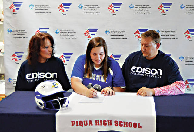 Rob Kiser|Miami Valley Today Piqua High School senior Mariah Blankenship signs her letter of intent to play for Edison State Community College. Looking on are her parents Angie and Eric Blankenship.